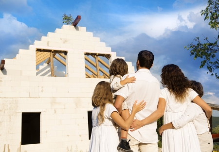 builds: Happy and big family builds a new house for living Stock Photo