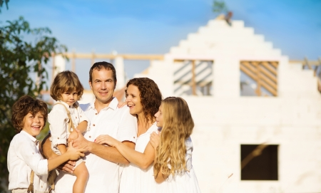 Happy and big family builds a new house for living Stok Fotoğraf