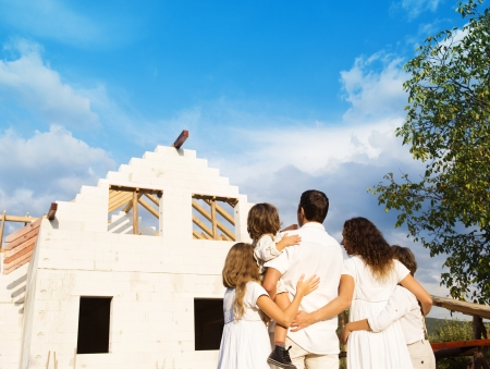 a big family: Happy and big family builds a new house for living Stock Photo