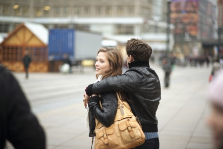 Tourist couple on vacation is walking around the city photo