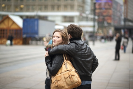 Hapy couple is having date in the street of city photo