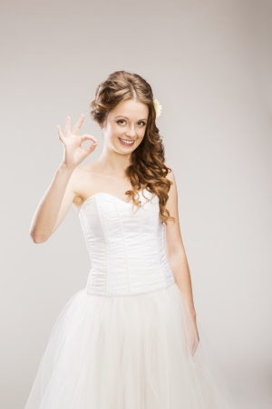 Studio portraits with beautiful bride isolated on gray background Stock Photo - 24238363