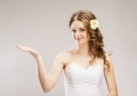 Studio portraits with beautiful bride isolated on gray background Stock Photo - 24238252