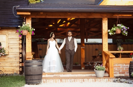 man outdoors: Beautiful bride and their country style wedding