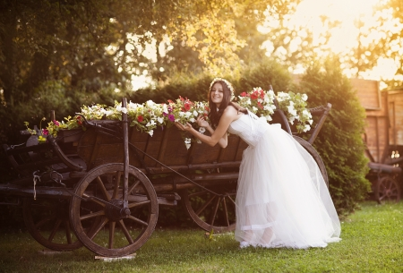 Beautiful bride in country style wedding dress photo