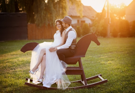 horse laugh: Beautiful bride and groom portrait in nature