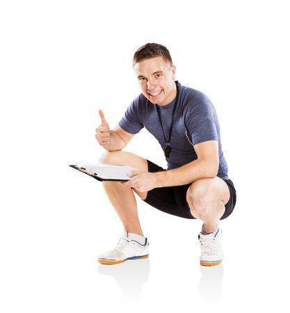 Profesional preparador físico aislado en fondo blanco Foto de archivo - 24963848