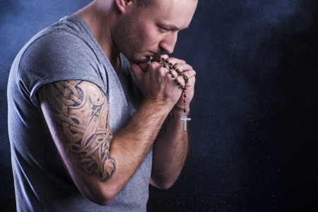 arm tattoo: Handsome young man with tattoo, isolated on black  Stock Photo
