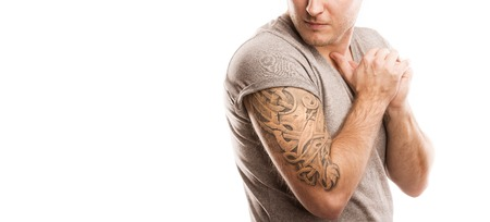 arm tattoo: Handsome young man with tattoo, isolated on white