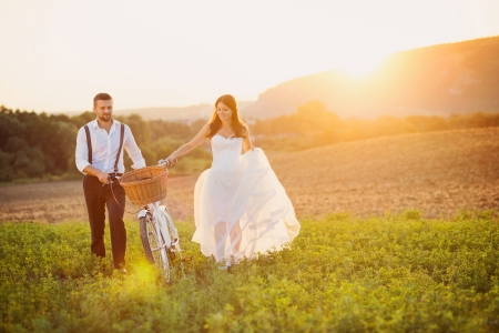 road bike: Beautiful bride and groom wedding portrait with white bike