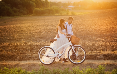 laughing couple: Beautiful bride and groom wedding portrait with white bike