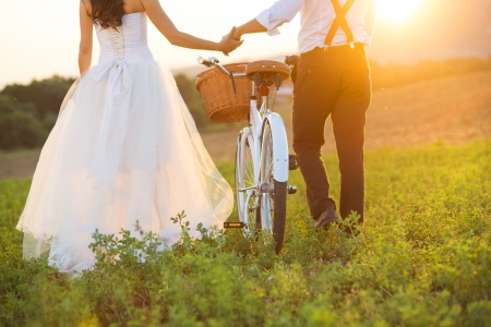 married together: Beautiful bride and groom wedding portrait with white bike
