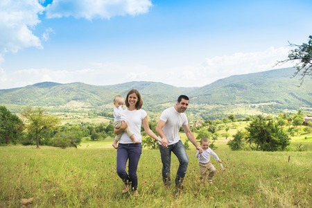 happy family nature: Happy family relaxing together in green nature Stock Photo