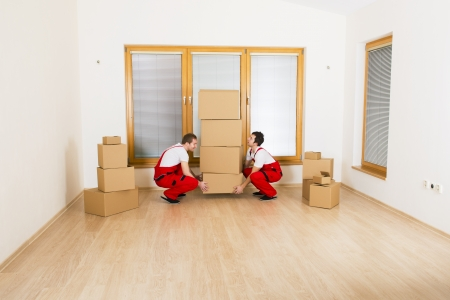 Movers in new house with lot of boxes  Stock Photo