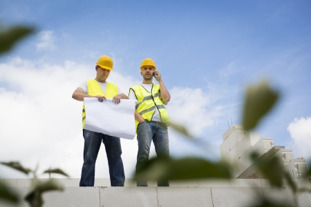 roof beam: Construction Contractors building a big new home Stock Photo