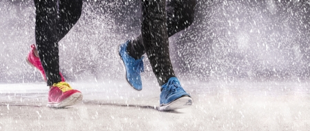 fast foot: Athlete woman and man are running during winter training outside in cold snow weather