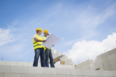 job site: Construction Contractors building a big new home Stock Photo