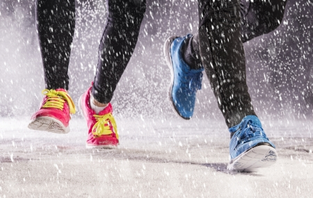 cold woman: Athlete woman and man are running during winter training outside in cold snow weather