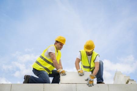 Construction Contractors building a big new home Stock Photo