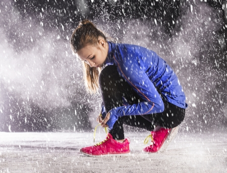 fast foot: Athlete woman is running during winter training outside in cold snow weather  Stock Photo
