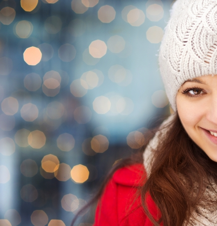 Close up portrait of winter girl in knitted clothes photo