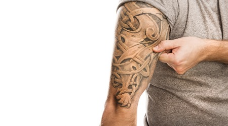 tatoo: Handsome young man with tattoo, isolated on white