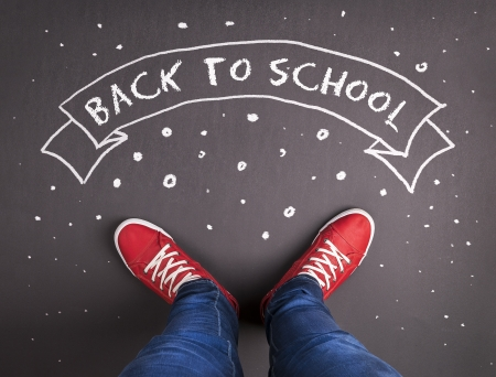 Back to school theme with hand drawn chalk sketched text on blackboard  photo