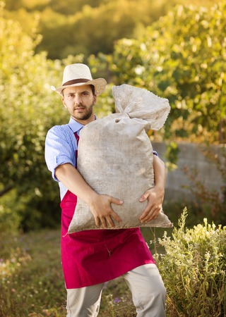 Gardener hold a big pack photo