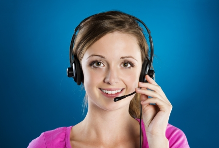Beautiful call center young woman is ready for business support photo