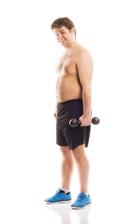 Fat fitness man is posing in studio on white background  photo