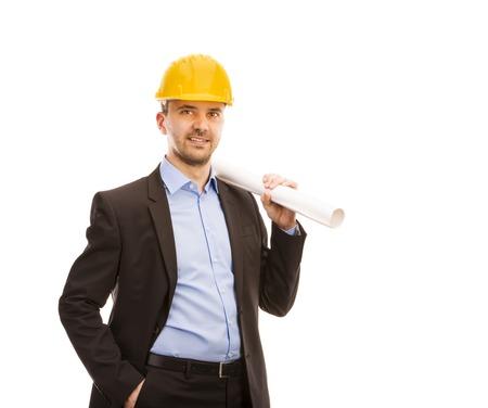 ingeniero civil: Ingeniero joven con el casco amarillo está aislado en el fondo blanco Foto de archivo
