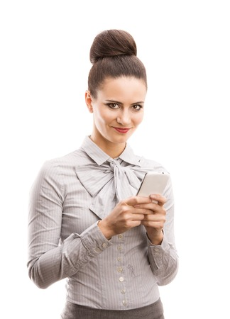 Beautiful business woman with smartphone isolated over white background  photo