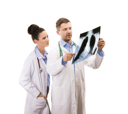 A medical team of doctors with X-ray, man and woman, isolated over white background photo