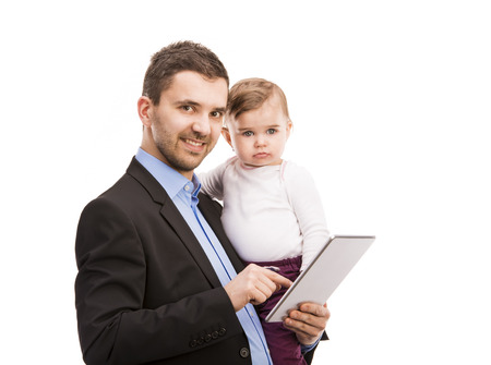Man with his baby is working  Manager is using digital tablet  photo