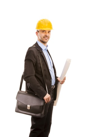 Young engineer with yellow helmet is isolated on white background  photo