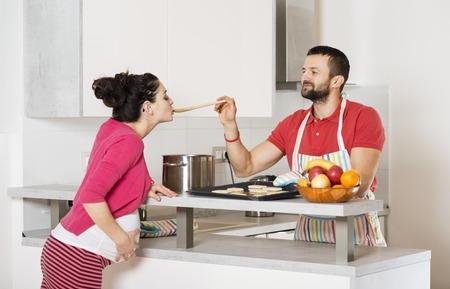 pot belly: Pregnant woman and happy man in the kitchen