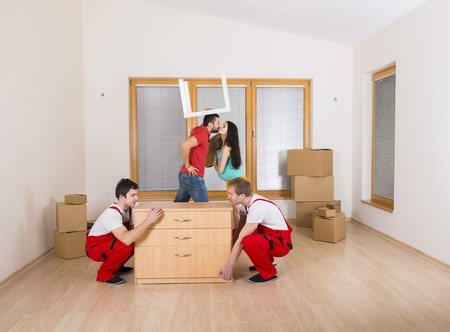 Movers in new house with young family photo