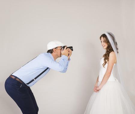 Studio portraits with beautiful bride and photographer photo