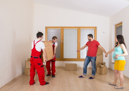 Movers in new house with young family Stok Fotoğraf - 26223350