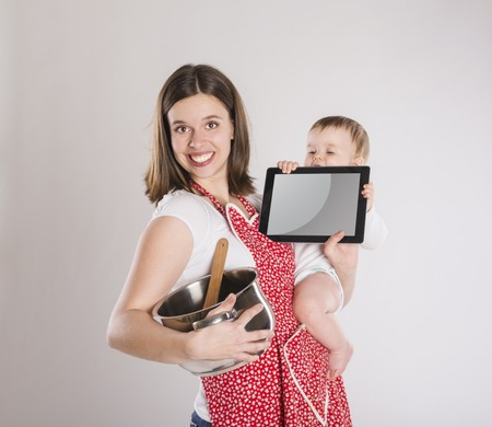 Busy mother and baby with digital tablet  photo