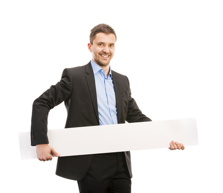 Successful business man is posing with blank copy space  Manager is isolated on white background  photo
