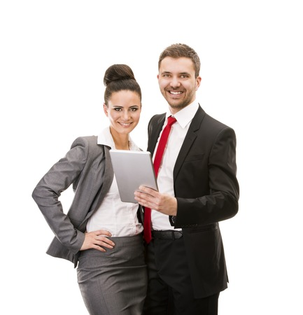 Young smiling business woman and business man isolated over white background with digital tablet Фото со стока