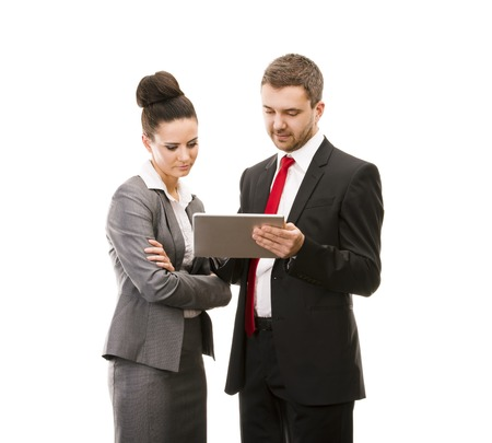 touch pad: Young smiling business woman and business man isolated over white background with digital tablet Stock Photo