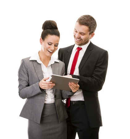 Young smiling business woman and business man isolated over white background with digital tablet photo