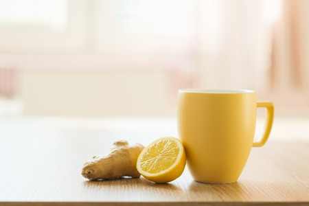 Cup of tea and lemon closeup with sunny house interior in background Stock Photo - 26337896