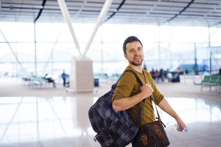 modernity: Young man is waiting at the airport for his flight   Stock Photo