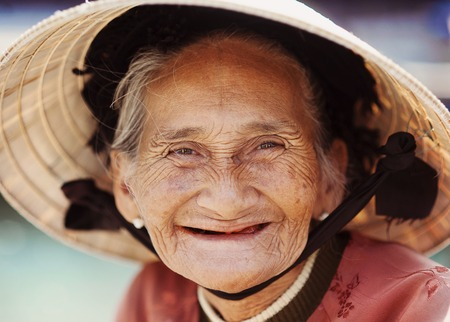 Close up face of beautiful smiling woman with wrinkles  Elderly senior  photo