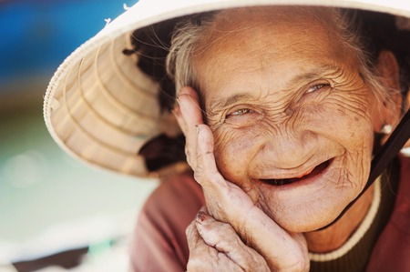 Close up face of beautiful smiling woman with wrinkles  Elderly senior