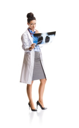 Smiling medical doctor woman with X-ray  Isolated on white background  photo