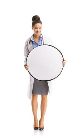 Smiling medical doctor woman with stethoscope  Full body portraits isolated on white background Stock Photo - 26529872